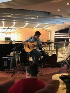 Matteo Palmer playing guitar